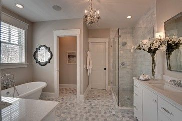 Revere Pewter by Benjamin Moore.  One of my favorite colors and it looks so beautiful in this bathroom.  Loving the floor tiles too!