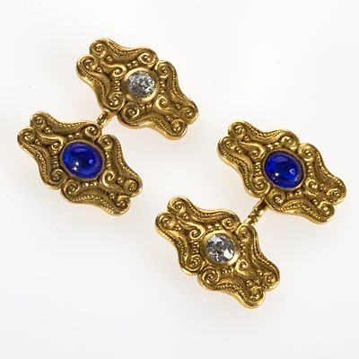 Gold, Sapphire and Diamond Cufflinks by T.B. Starr  A pair of American Art Nouveau 18 karat gold cuff links with diamonds and blue sapphires. The cuff links are double sided and feature 2 old European-cut diamonds with an approximate total weight of .60 carats, and 2 cabochon blue sapphire with an approximate total weight of .90 carats | JV