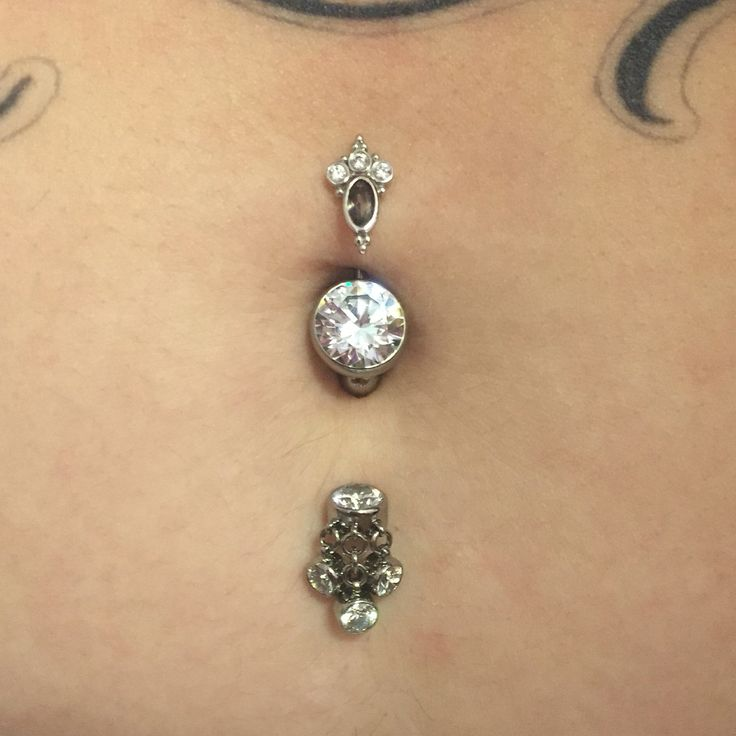 Check out this awesome double navel piercing with some of our titanium curves...all jewelry available for worldwide shipping!