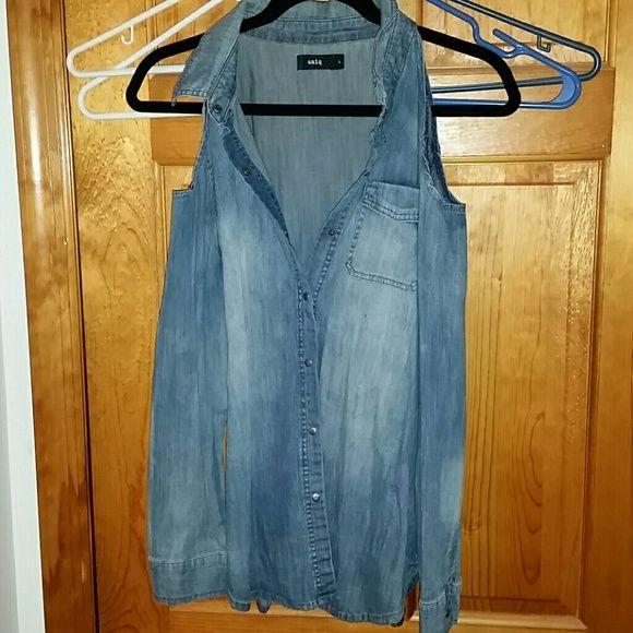 Denim cutout shirt Cutouts in the shoulders for a little peep. 98% cotton,  2% spandex. Tops Button Down Shirts