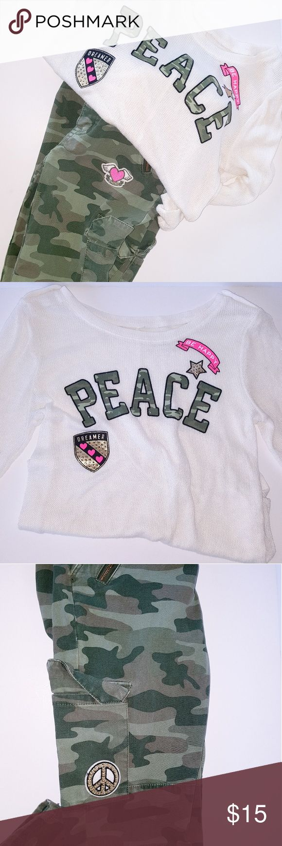 Pre owned girls (Peace) outfit from Justice In excellent condition Peace Army outfit from justice. Light weight sweater with army pants. Size 12 girls.. Justice Matching Sets