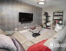 Second floor bonus room. Wallpaper, leather sectional. Luxury 3 bedroom townhomes. The Intrigue model, by Kimberley Communities.