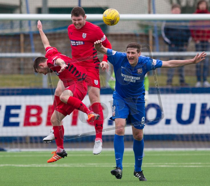 Queen's Park's Ryan McGeever wins the header during the SPFL League Two game between Montrose and Queen's Park.