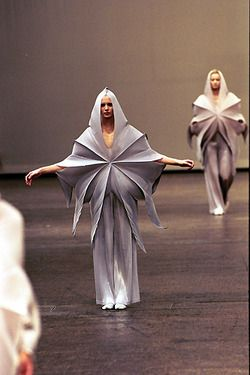 Issey Miyake F/W 1999: looking at ways that shape relates to the body. How can unconventional shapes (eg. non tailored forms) explore ways of clothing/distorting the body: is the body a canvas for the shapes rather than the clothing conforming/complementing the body?