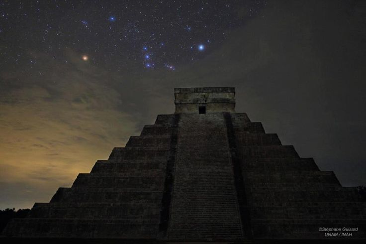 Dramatic picture of Orion rising over El Castillo, the central pyramid at Chichén Itzá, one of the great Mayan centers on the Yucatán peninsula. Also known as the Temple of Kukulkan it stands 30 meters tall and 55 meters wide at the base. Built up as a series of square terraces by the pre-Columbian civilization between the 9th and 12th century, the structure can be used as a calendar and is noted for astronomical alignments.