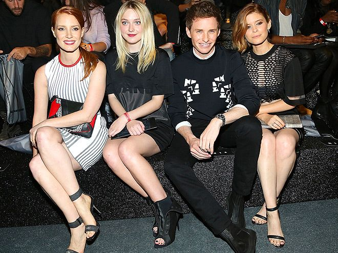 Star Tracks: Friday, October 17, 2014 | THE FAB FOUR | Jessica Chastain, Dakota Fanning, Eddie Redmayne and Kate Mara pack the front row with loads of star power at the Alexander Wang x H&M Collection launch on Thursday at the Armory on the Hudson in New York City.