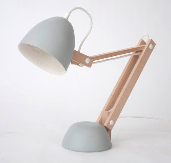 A desk lamp crafted from wood and clay.