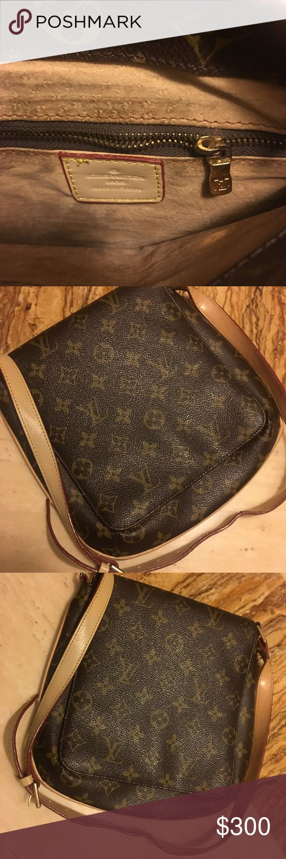 Louis Vuitton cross body bag Unisex. Used, authentic, genuine leather Louis Vuitton cross body bag. Little to no sign of usage, only marks are not visible n are located inside the bag as well as usage of strap. Louis Vuitton Bags Crossbody Bags