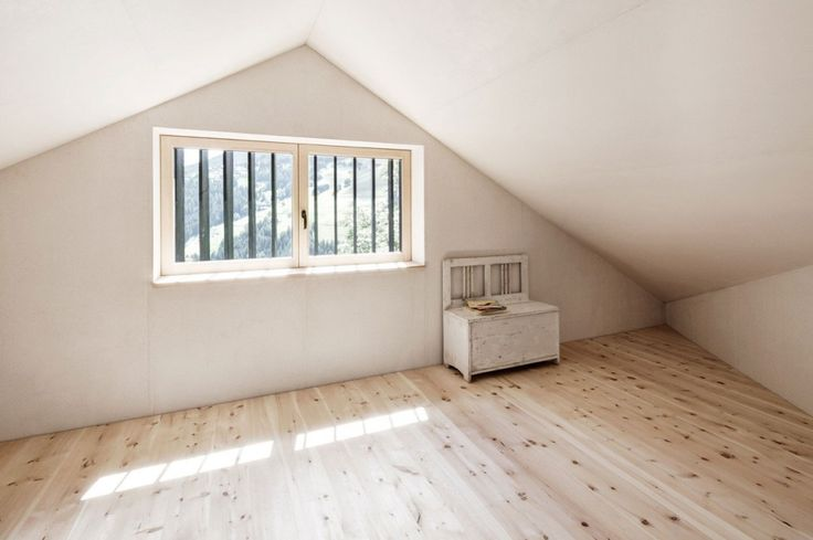 A Breathtaking Attic With Simply Wooden Table And Cedar Flooring With Antique Cedar Wood Cabinet Black House on a Steep Slope in a Small Germany Village Home design