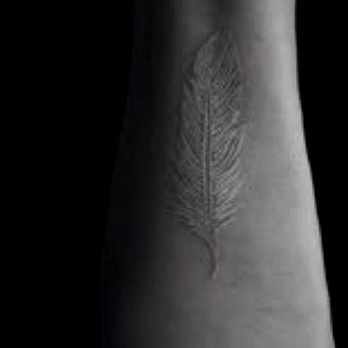 White feather tattoo.
