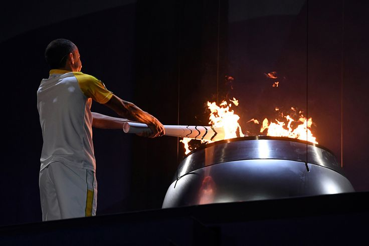 Vanderlei Cordeiro de Lima lights the Olympic cauldron with the Olympic torch on August 5, 2016.