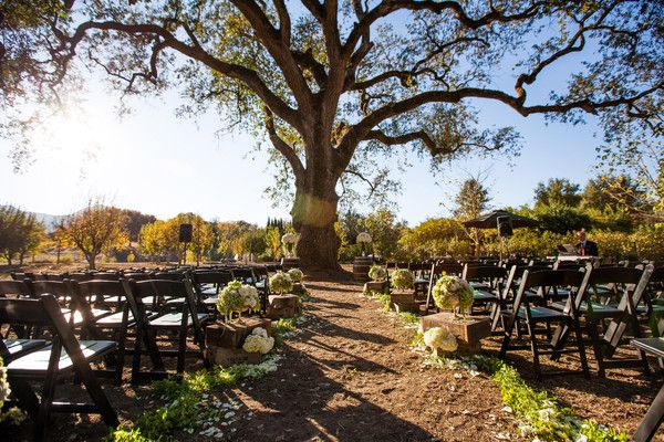 A fall wedding underneath our mother oak. Stunning November wedding at Campovida. Floral Designer: Miss Meliss Floral Design Event Planner: Where to Start, Inc. Wedding and Event Management Dress Designer: Matthew Christopher Bridesmaid Dresses: Monique Lhuillier Hair Stylist: Bella Bridal Napa Valley Makeup Artist: Make-up Artistry by Alan Groom and Groomsmen Attire: Jos. A. Bank Floral Designer: Miss Meliss Floral Design Rentals: Classic Party Rentals Venue: Campovida