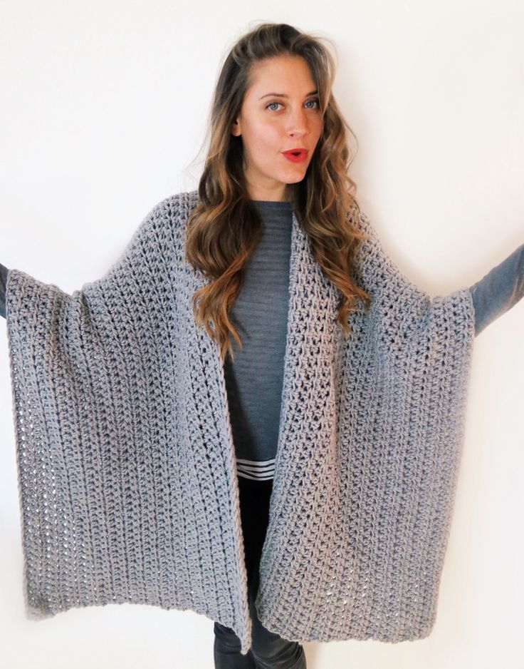 """Worn by natives of several regions in South America, the ruana is a  versatile garment that literally translates to """"land of blankets."""" It can  be worn simply draped over the shoulders, belted, or wrapped across the  front of the body to cover the chest and neck. The Blanket Ruana adds a  touch of bohemian elegance to any ensemble.  This is an easy crochet pattern, and the technique used is half double  crochet.  Dimensions of finished garment: Length: 32""""/81.2cm Width: 42""""/106.7cm *one size…"""