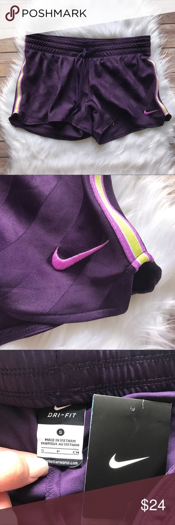"Nike Dri-Fit Training Shorts Size Small NWT Purple running/training shorts by Nike. Subtle striped short with yellow racing stripe on edge. Pink Nike logo embroidered on bottom leg. 3.5"" inseam. NWT from a smoke free home!  ⭐️no trades⭐️ ⭐️I'm open to offers and I ALWAYS send a counteroffer⭐️ ⭐️bundle and save 10% off two or more items⭐️ Nike Shorts"