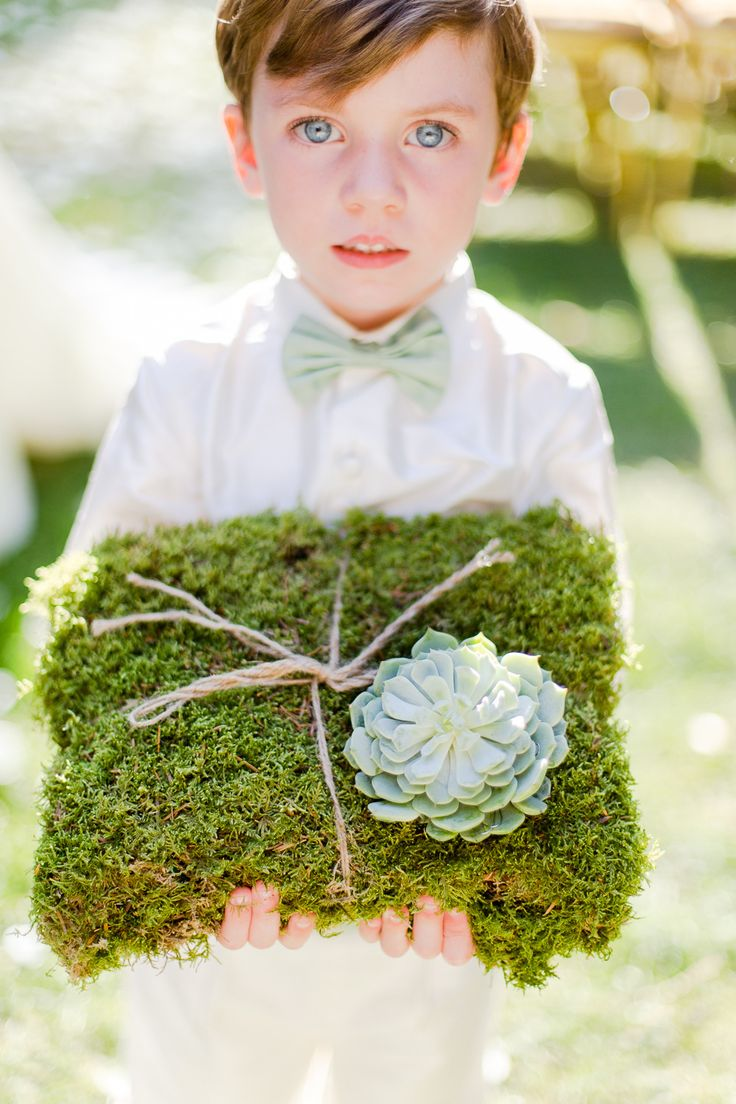 Moss Ring Pillow + a big juicy Succulent || On Style Me Pretty: http://www.stylemepretty.com/destination-weddings/2014/02/21/grayed-jade-sophisticated-garden-wedding-ideas/ Photography: Eddie Judd