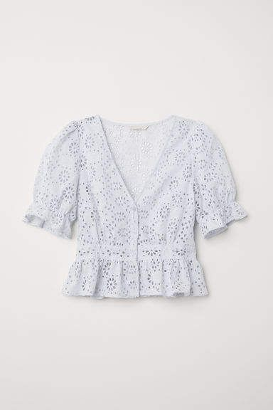 70c3b0c3628665 Blouse in an airy, woven cotton blend with eyelet embroidery. V-neck,  buttons at front, and short puff sleeves with elasticized cuffs with ruffle  trim. Seam