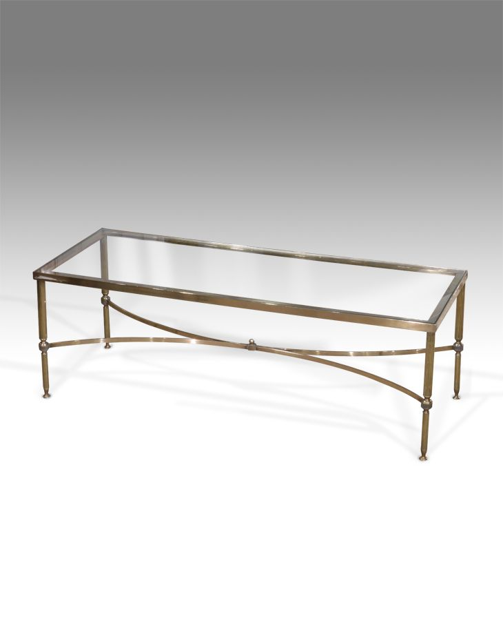 elegant century brass and glass coffee table single glass tier raised on solid reeded brass legs united with a cross stretcher