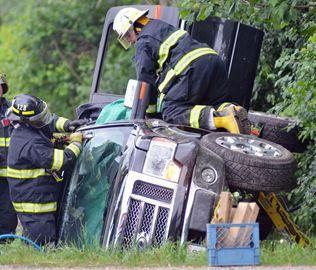 Picture of us cutting accident victim out of truck by Peterborough This Week