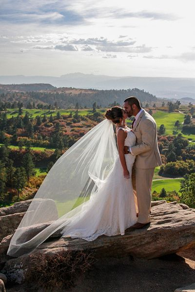 Long veils are no longer strictly reserved for houses of worship — they're popping up in pastoral farm weddings, beautiful beachfront receptions, and more non-traditional settings.
