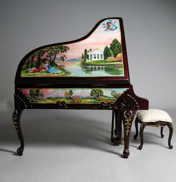 How big do you think this piano is? The picture is a little deceiving, but this is actually a hand painted Bespaq (doll house) piano. Even more impressive considering how tiny these details are.