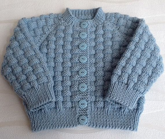 Hand knitted blue baby cardigan. Cashmerino baby by emilyandevelyn