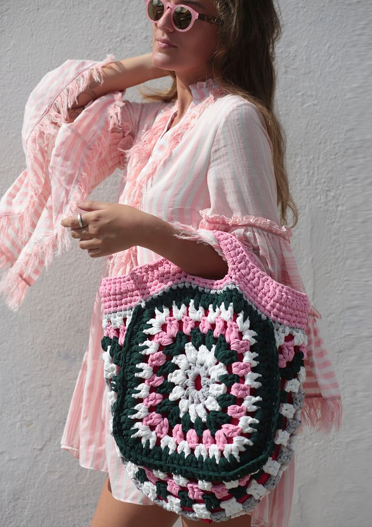 Our open top tote bag is satin lined and hand-crocheted with vibrant recycled co…