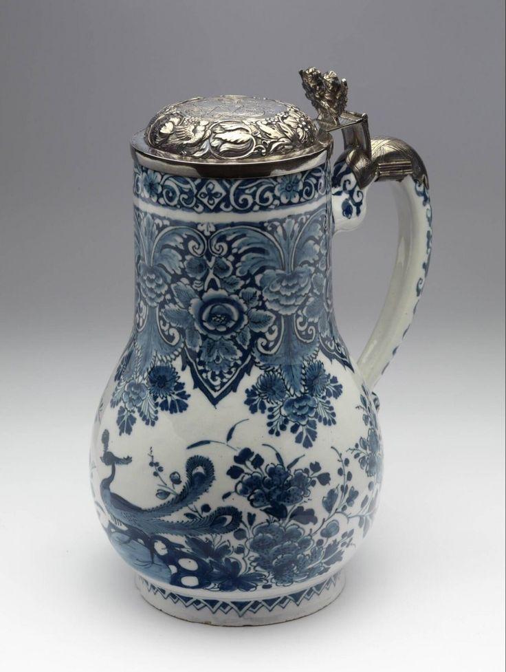 Dutch Delft jug with silver lid. Pieter Adriaansz. Kocx, factory De Grieksche A, 1701-1720. Depth: 17,8 cm Width: 14 cm Height: 24,2 cm. Jeroen PM Hartgers