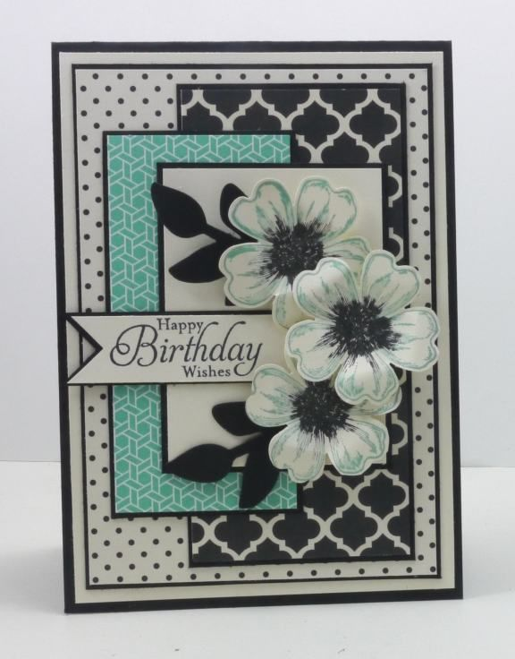 handmade birthday card ... Freshly Made Sketches #95 ... layers of patterned paper matted in black ... black and white with touches of aqua ... lovely flowers stamped, punched out, shaped and popped up ... great card ... Stampin' Up!