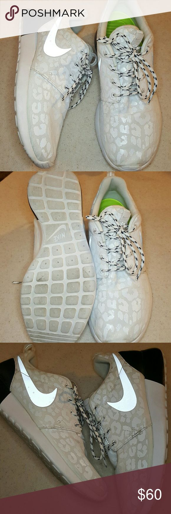 [Nike] Leopard Roshe Run White leopard print with a silver/reflective swoosh. Super clean and barely worn in great condition! The tab on back of left shoe is torn(see last pic). Barely noticeable and probably could fix it if bothered you.   Open to offers! I wanted to keep these but just a little bit too snug for me! Nike Shoes Athletic Shoes