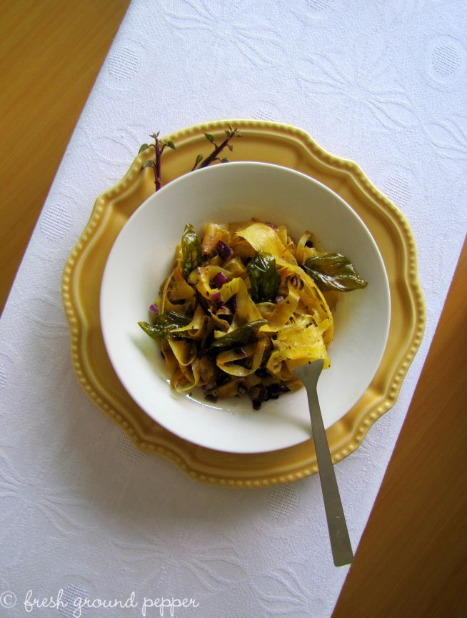 Sweet potato pasta with herbs and spices in butter sauce