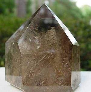 Smoky Quartz Meaning and Feng Shui Use: This beautiful smoky quartz generator carries strong grounding, protective and balancing energy. It is also uplifting/ filled with light and golden inclusions (rutiles) which makes for a powerful feng shui combination for any space, be it home or office.