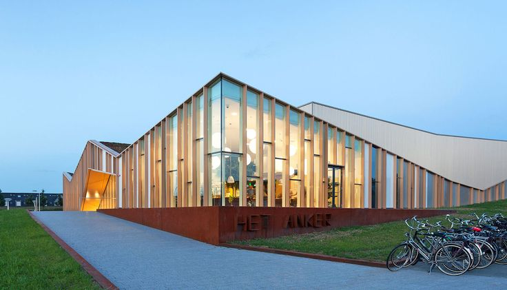 Zigzagging Het Anker community center in the Netherlands is partially buried underground