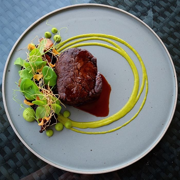 beef, forbidden rice, king trumpet adobo, pea parsley puree, miner's lettuce, green garlic vinaigrette, garlic roots and chips