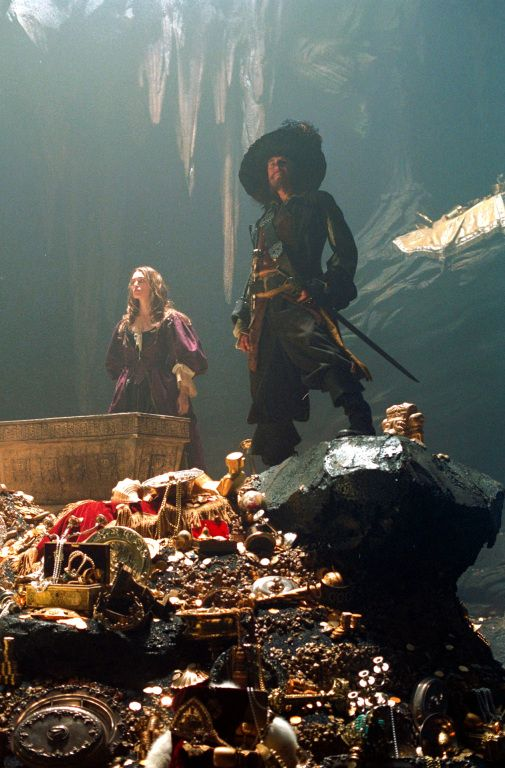 Elizabeth Swann and Captain Hector Barbossa - Keira Knightley and Geoffrey Rush in Pirates of the Caribbean: The Curse of the Black Pearl (2003).