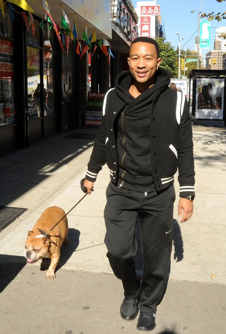 Good doggie. John Legend and his bulldog Puddy stroll through New York on Oct. 28: John Legend, Photo