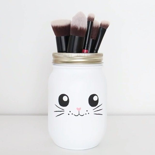 DIY Makeup Brush Holder using a mason jar  So if you were not  able to tell, this is actually a cat face but it kinda looks like a bunny too  idk but either way I think it turned out super cute. I did three more easy ROOM DIYS over on my YouTube channel (link in bio) so go check it out ❤️ love you guys - Nim