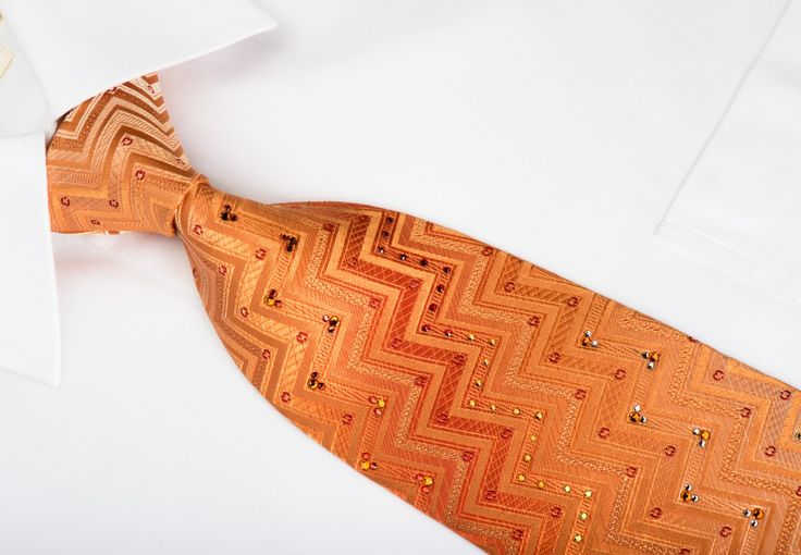 Stylish silk Rhinestone necktie perfect style for occasion, handmade and designed by top brand name Mila Schon. Presenting an elegant geometric Chevron design on orange silk and sparkling with white, orange Rhinestones and silver sparkles.