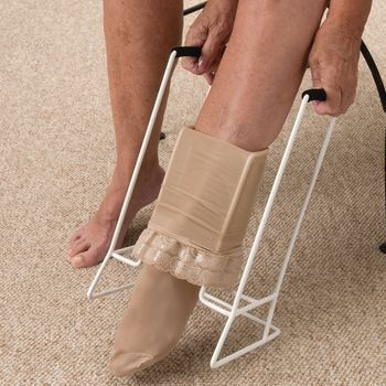 "Jobst Stocking Donner by Rolyn Prest. $55.05. (SEE AVAILABILITY ABOVE FOR ESTIMATED DELIVERY) - Jobst Stocking Donner - Jobst Stocking Donner - Designed to help individuals with limited strength & mobility pull on vascular stockings. Foam grip handles make it easy to pull & a durable baked epoxy finish provides a smooth, no - snag surface. Measures 13""W x 13½""H between handles & 4¼""W foot insert. Latex free. - Rolyan products are internationally licensed & manufactured for hom..."