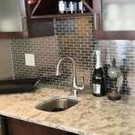 Our heavy duty stainless steel mosaic tiles are made with a heavy porcelain base, double A grade stainless steel with a mesh backing for easy installation. These stainless steel tiles are great for vertical surfaces such as a backsplash for a stove top in the kitchen. Unsanded grout is required for the installation for stainless steel tiles.   Stainless steel 1x3 are sold in square foot mesh mounted sheets in an interlocking pattern.