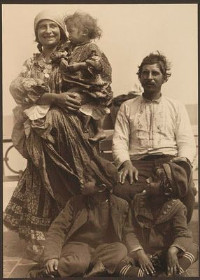 She sure looks happy!....Gypsy Family arriving at Ellis Island, New York, 1912