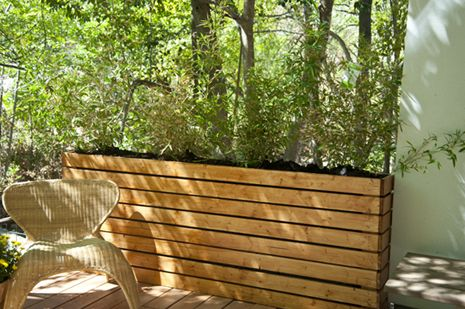How to Build a half-wall planter box, very cool! no bending to reach plants, no weeds, and can act as a wall or barrier, love it !