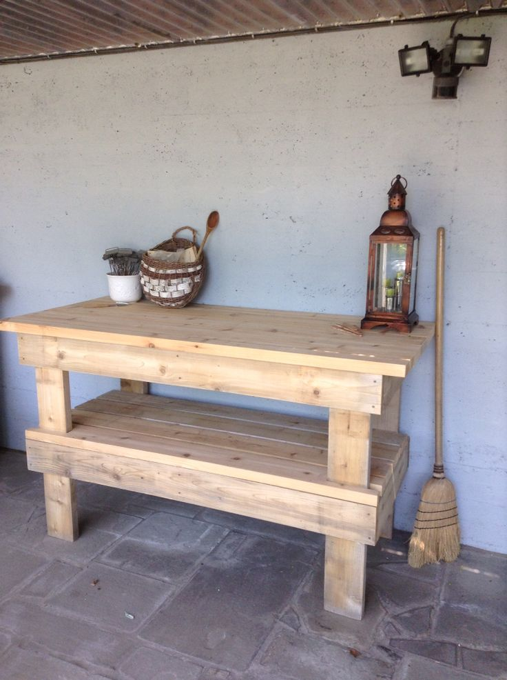 """My cedar potting bench -2014.  Mike, Dad, & I designed and made it from leftover deck wood.  """"You can fix tractor engines on it; it's a little over-built for a potting bench,"""" ...my dad, the industrial arts teacher."""