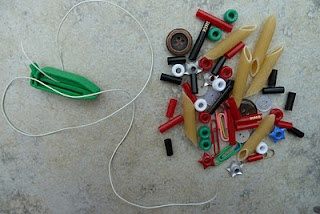 Toddler busy bag activity - threading. Excellent for fine motor and visual perceptual development.