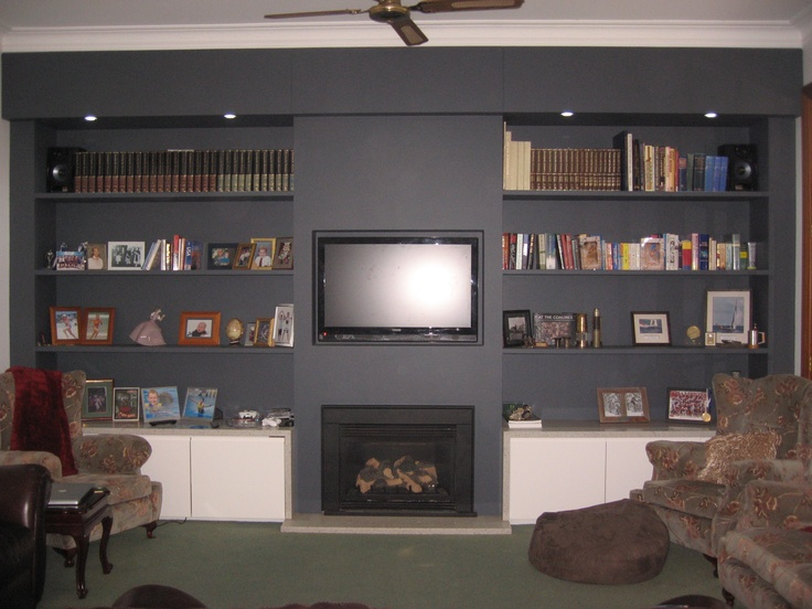 Storage Wall incorporating Fireplace, bookshelves, cupboards and TV