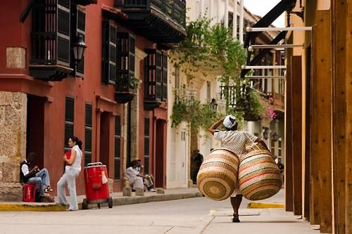 View of a basket seller walking the streets of Cartagena, an old colonial city in Colombia