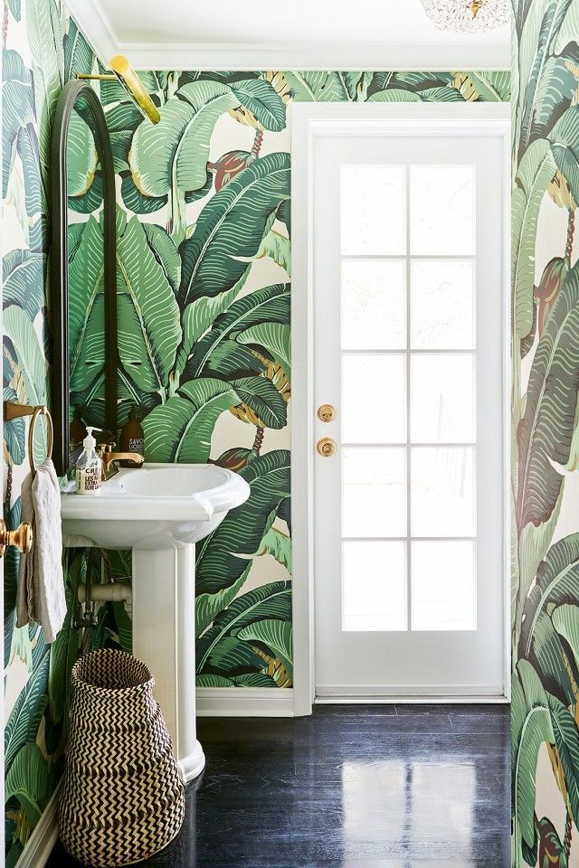 Small Power Room With Tropical Wallpaper And Woven Basket