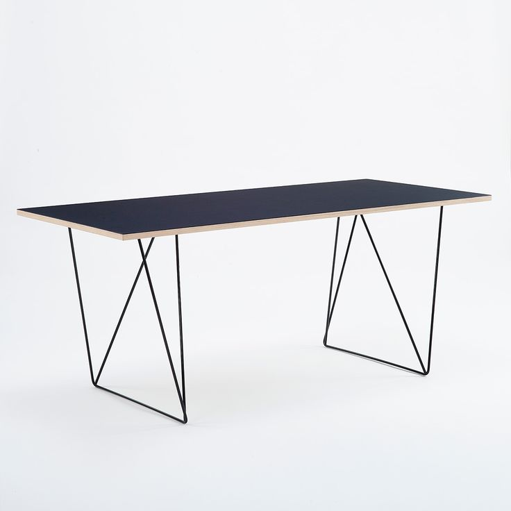Reverse table legs in black combined with linoleum table top with oak egde