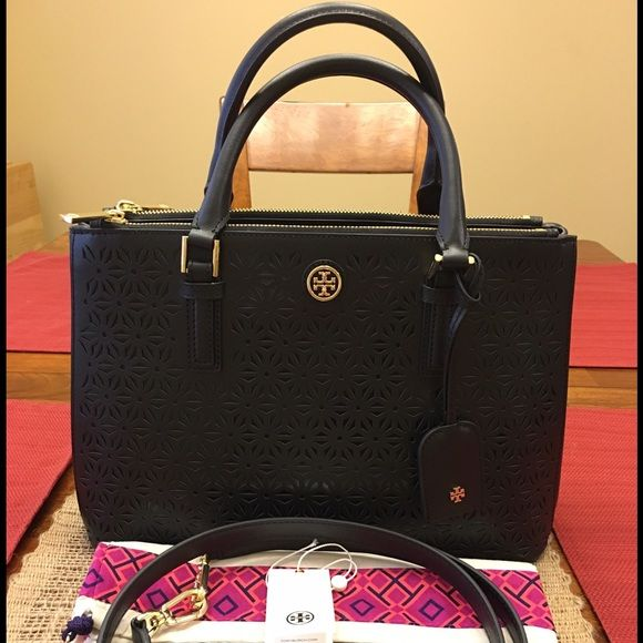 "Tory Burch Perforated Saffiano Robinson Satchel 100% Authentic, used 1x only, In mint condition. Smoke free pet free home. NO TRADES ACCEPTED! Gold hardware in beautiful condition. Retail $550 before tax(what I paid!). Comes with all original packaging, tag, dustbag, 23"" adjustable detachable strap. Interior has several pockets. Two exterior zip pockets that extend the length of the bag (zippers on top as shown). FIRM $300 applies to ♏️ercari only! Tory Burch Bags Satchels"