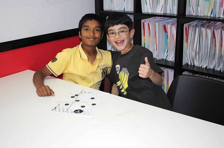 These students show how math is more fun with friends. Bring a friend to Mathnasium!