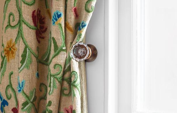 Use a vintage doorknob as a curtain tieback
